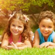 Happy kids on green grass — Stock Photo