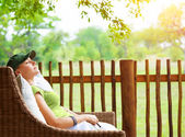Cute girl resting on veranda — Stock Photo
