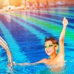 Happy winner in the pool — Stock Photo #27392257