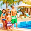Happy family near pool — Stock Photo #27392473