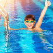 Little boy in the pool — Stock Photo #27393295