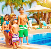 Happy family near pool — Stock Photo