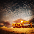 Old excavator on sunset — Stock Photo