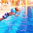 Small boy jumping to the pool — Stok fotoğraf
