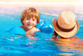 Little boy with mom in the pool — Stock Photo
