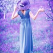 Woman in fantasy garden — Stock Photo