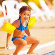 Little girl preparing to jump into water — Stock Photo #27719913