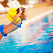 Little girl jumping into the pool — Stock Photo