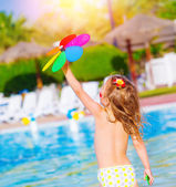 Baby girl in waterpark — Stock Photo