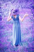 Woman in fantasy garden — Stock Photo