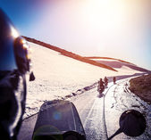 Group of bikers on snowy road — Stock Photo