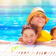 Happy family in the pool — Stock Photo