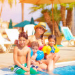 Big family near poolside — Stock Photo