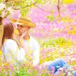 Happy couple kissing outdoors — Stock Photo