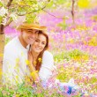 Woman and man on floral field — Stockfoto