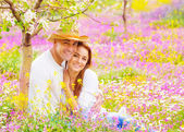 Woman and man on floral field — Stock Photo