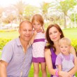 Young family in the park — Stock Photo