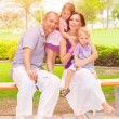 Cute family in the park — Stock Photo