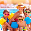 Happy family at the pool — Stockfoto