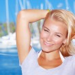 Cute girl in yacht harbor — Stock Photo