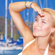 Pretty girl in yacht harbor — Stock Photo