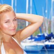 Beautiful woman in sailboat harbor — Stock Photo