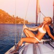 Sexy woman tanning on yacht — Stock Photo