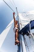 Cute sailor fix sail — Stock Photo