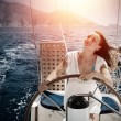 Woman behind the wheel yacht — Stock Photo