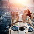 Woman behind the wheel yacht — Stok fotoğraf
