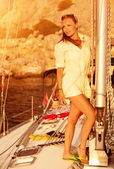 Beautiful model on the yacht on sunset — Stock Photo