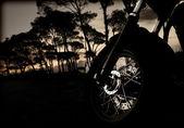 Motorcycle wheel on sunset — Stock Photo