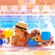 Happy family in the pool — Stock Photo