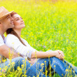Happy couple on floral field — Stock Photo