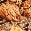 Grilled meat steak on mangal — Stock Photo