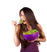 Attractive female eat salad — Stock Photo