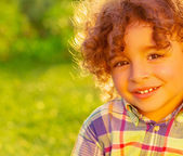 Cheerful child on summer field — Stock Photo
