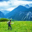 Traveler girl in the mountains — Stock Photo