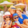 Mother with kids on beach resort — Stock Photo