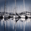 Постер, плакат: Sail boat harbor in evening