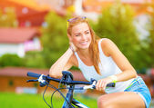 Happy woman on the bicycle — Stock Photo