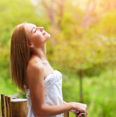 Calm woman on terrace — Stock Photo