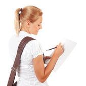 Schüler mädchen schreiben prüfungen — Stockfoto