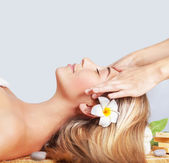 Calm woman enjoying massage — Stock Photo
