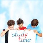 Three school boys with text board — Stock Photo