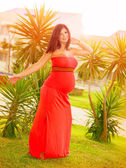 Pregnant girl dancing outdoors — Stock Photo
