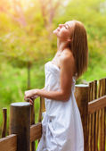 Pretty woman on balcony — Stock Photo