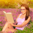 Woman read book outdoors — Stock Photo