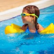 Happy little girl in the pool — Stock Photo