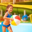 Little girl with ball near pool — Foto de Stock